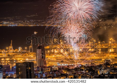 Fireworks celebrating 68 Independence day of Israel over Haifa bay. - stock photo