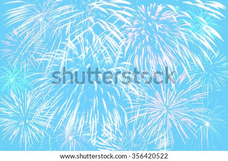 Fireworks celebration on pastel cyan colour background. - stock photo