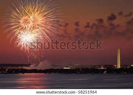 Fireworks celebration over the Washington skyline with Washington Monument visible.