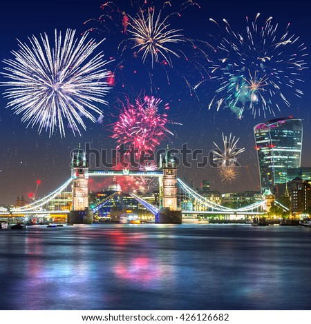 Fireworks display over the Tower Bridge in London, UK - stock photo