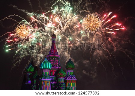 Fireworks explode over St. Basil Cathedral at night in Red Square in Moscow, Russia. - stock photo