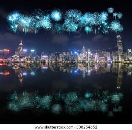 Fireworks Festival over Hong Kong city with water reflection, view from Victoria Harbour