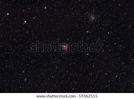 Fireworks Galaxy and the NGC 6946 Cluster - stock photo