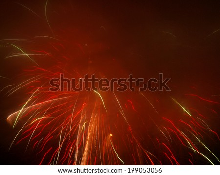 Fireworks in a Hazy Cloudy Night Sky - stock photo