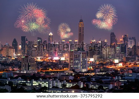 Fireworks light up on sky over Bangkok City downtown with hotel, condominium and high rise building,Thailand. Bangkok is the most populated city in Southeast Asia. - stock photo