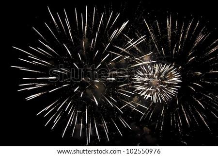 fireworks on a dark night sky - stock photo