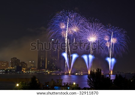 Fireworks on Detroit River celebrating the national days of Canada and USA. - stock photo