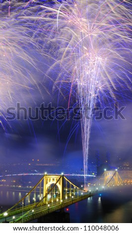 Fireworks on the Allegheny river in downtown  Pittsburgh, Pennsylvania, USA. - stock photo