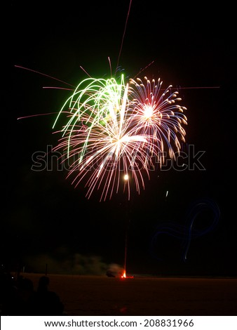 Fireworks on the Beach with LED Light Trails from Kites - stock photo