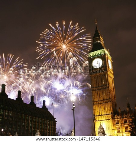 Fireworks over Big Ben at midnight, New Years Eve - stock photo