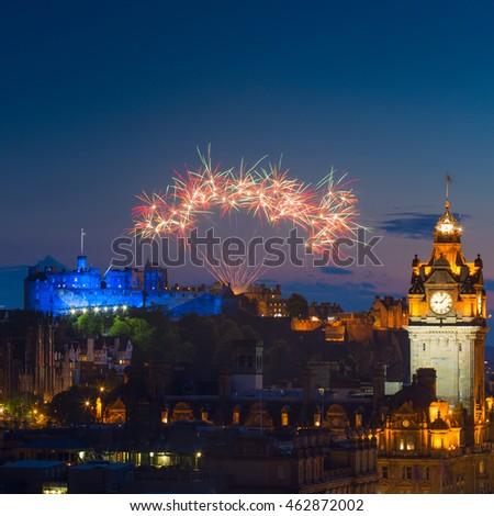Fireworks over Castle and Balmoral Clock Tower during The Edinburgh International Festival aka The Fringe, Scotland, UK.