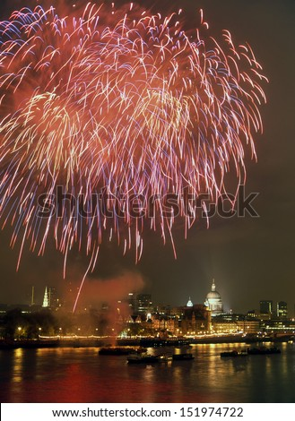 Fireworks over River Thames London with dome of St Pauls cathedral - stock photo