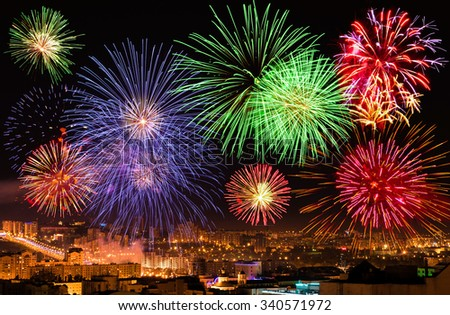Fireworks over the city - stock photo