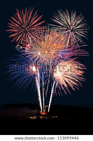 Fireworks Show Against the Night - 4th of July fireworks show in the United States  - stock photo