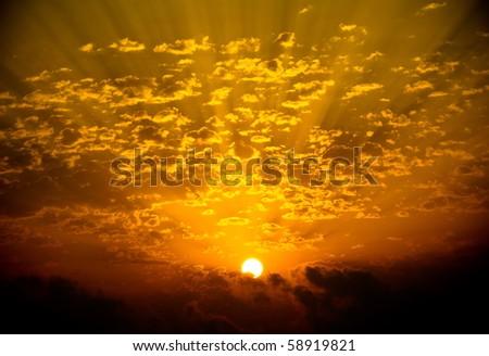 Firey sunset at the seaside - stock photo