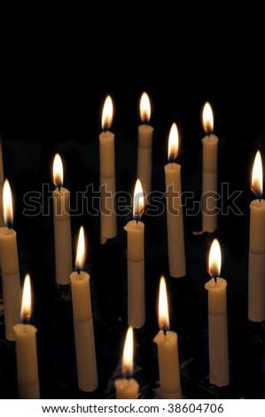 Firing church candles on dark - stock photo