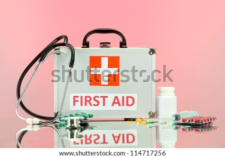 First aid box, on pink background - stock photo