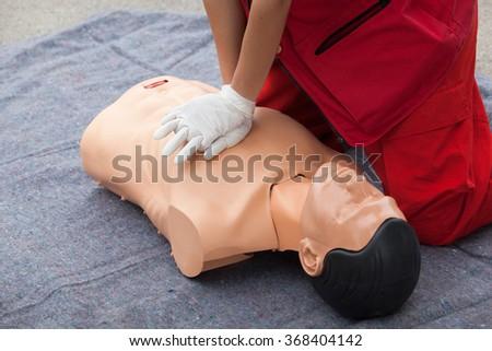 First aid. Cardiac massage. - stock photo