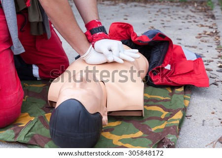 First aid. Heart massage. - stock photo