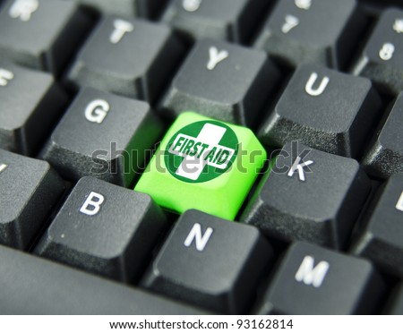 First aid icon on green keyboard button. Concept on computer keyboard. - stock photo
