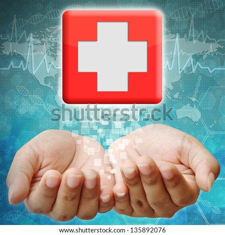 First Aid icon on hand ,medical background - stock photo