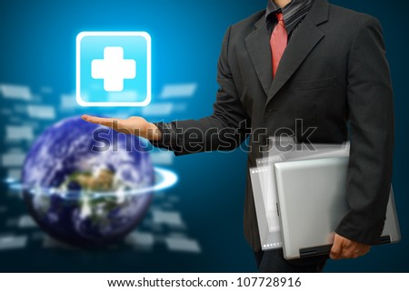 First Aid icon on smart hand : Elements of this image furnished by NASA - stock photo