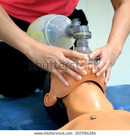 First aid instructor showing resuscitation technique - stock photo