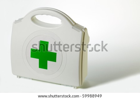 First aid kit and shadow. - stock photo