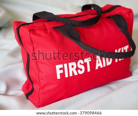 First Aid Kit Closeup. A first aid kit bag in closeup, against a neutral background. - stock photo