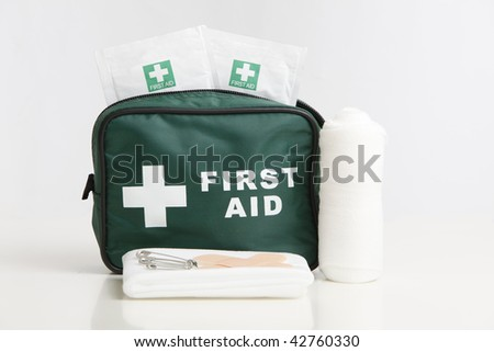 First Aid kit with bandage, plasters,and wipes isolated on a white - stock photo