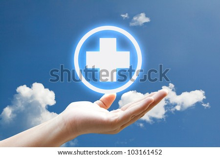 First aid sign floating in the sky - stock photo