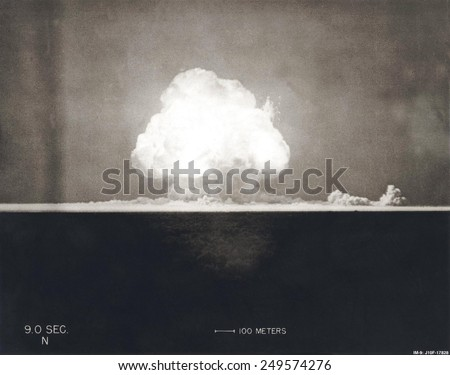 First Atomic Explosion on July 16, 1945. Photograph taken at 9 seconds after the initial Trinity detonation shows the Mushroom cloud. Manhattan Project, World War 2. Alamogordo, New Mexico. - stock photo