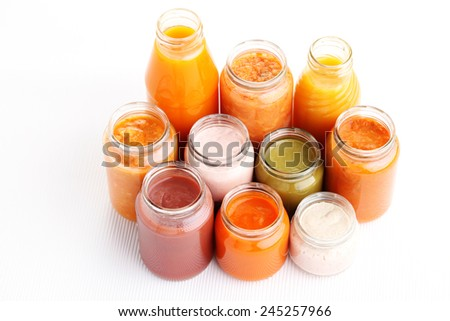 first baby food in jar - food and drink - stock photo