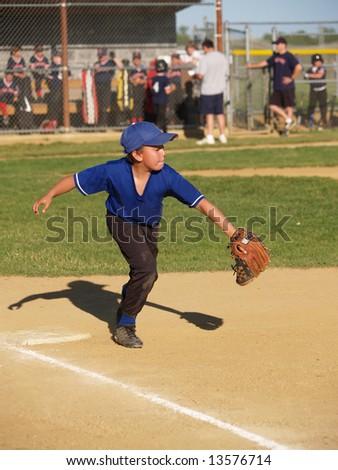 First baseman catching the baseball - stock photo