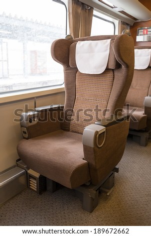 first class seat on the train - stock photo