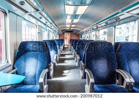 first class train carriage with blue seats