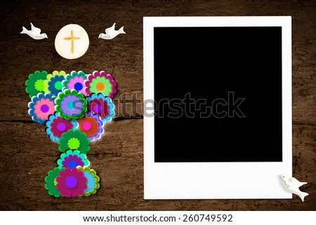 First communion, chalice and picture frame on wooden background - stock photo