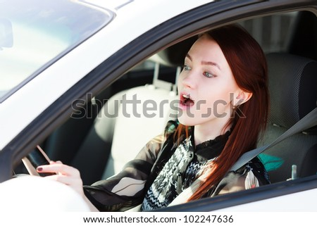First day on the road. Scared girl in a car - stock photo