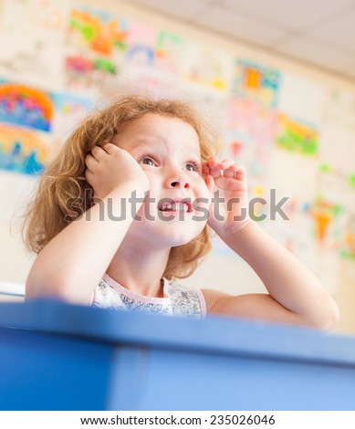 First grader in a classroom - stock photo