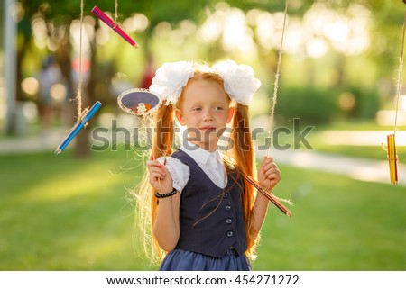 first grader in the meadow - stock photo