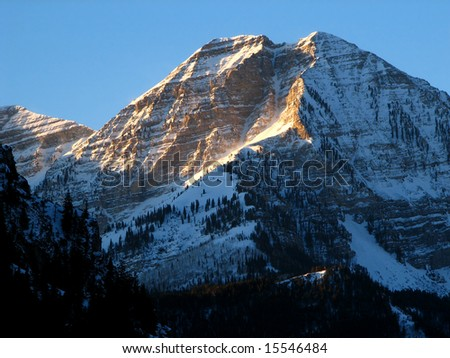First light on Mt. Timpanogos on a clear morning - stock photo