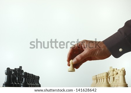 first move on the chess board - stock photo