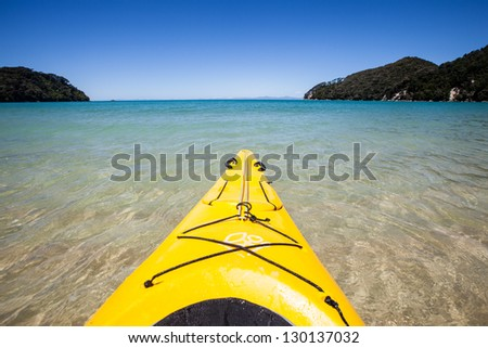 First person view kayaking through clear water - stock photo