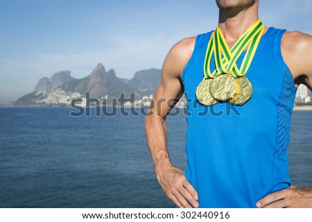 First place athlete wearing a collection of gold medals standing outdoors in Rio de Janeiro Brazil  - stock photo