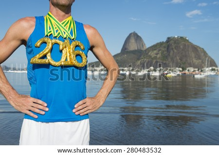 First place athlete wearing gold 2016 medals standing outdoors at Botafogo Bay Rio de Janeiro Brazil  - stock photo