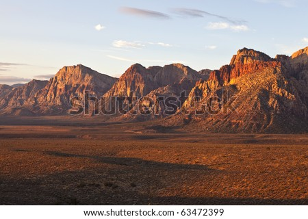 First rays of warm sunrise light in Nevada's Red Rock Conservation Area. - stock photo