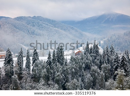 First snow in mountain village. Ukraine - stock photo