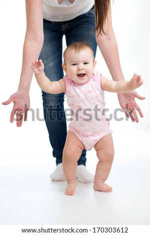 First steps of baby isolated on white - stock photo
