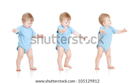 First steps of baby isolated on white background - stock photo