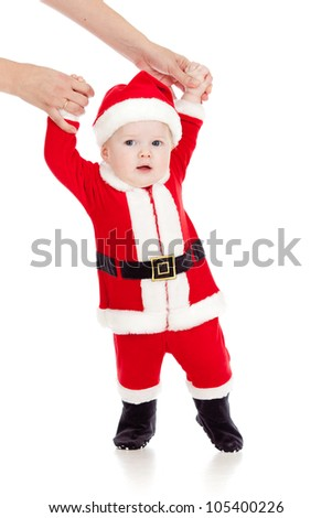 first steps of Santa claus baby - stock photo